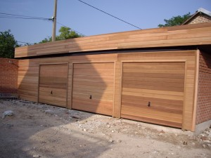Construction garage bois sur mesure toit plat autoclave adoss - Garage ossature bois prix ...