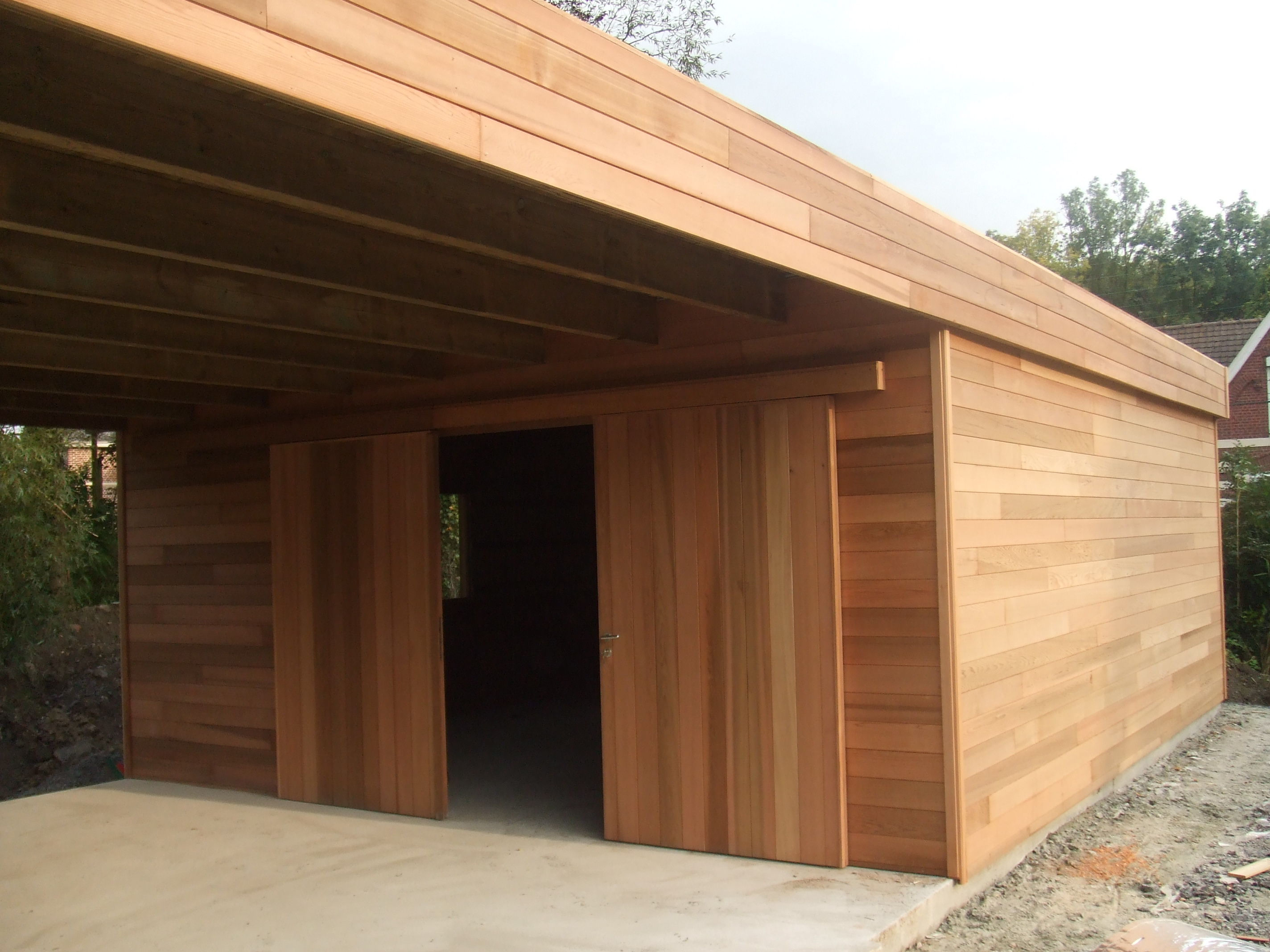 Garage bois sur mesure garage carport en red cedar for Garage en bois autoclave